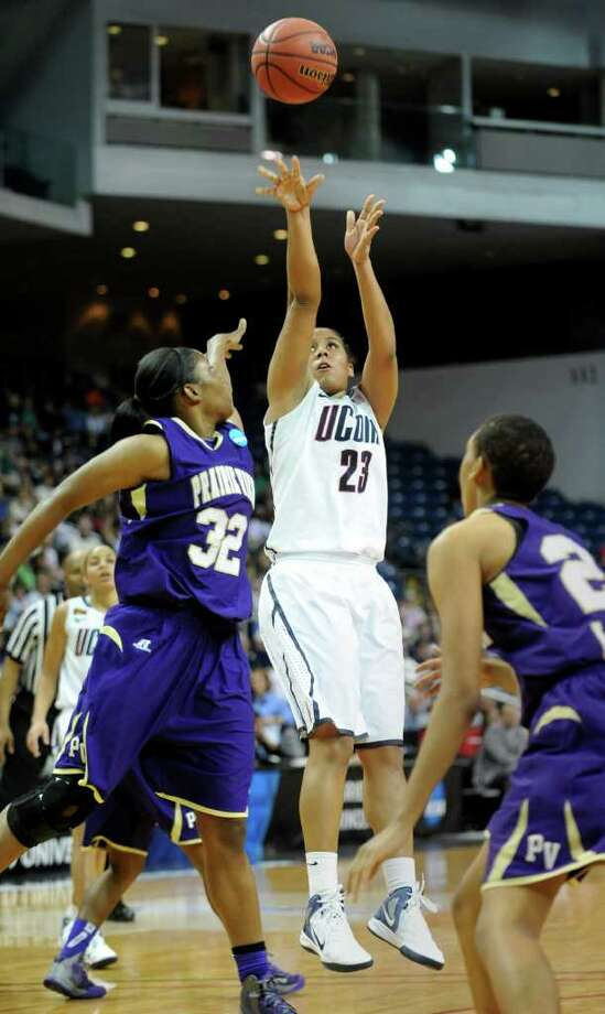 Connecticut's Kaleena Mosqueda-Lewis attempts a 3-point shot as Prairie View's Kiara Etienne, left, guards her during the first-round NCAA game at the Webster Bank Arena in Bridgeport, Conn. Saturday, Mar. 17, 2012. Photo: Autumn Driscoll / Connecticut Post