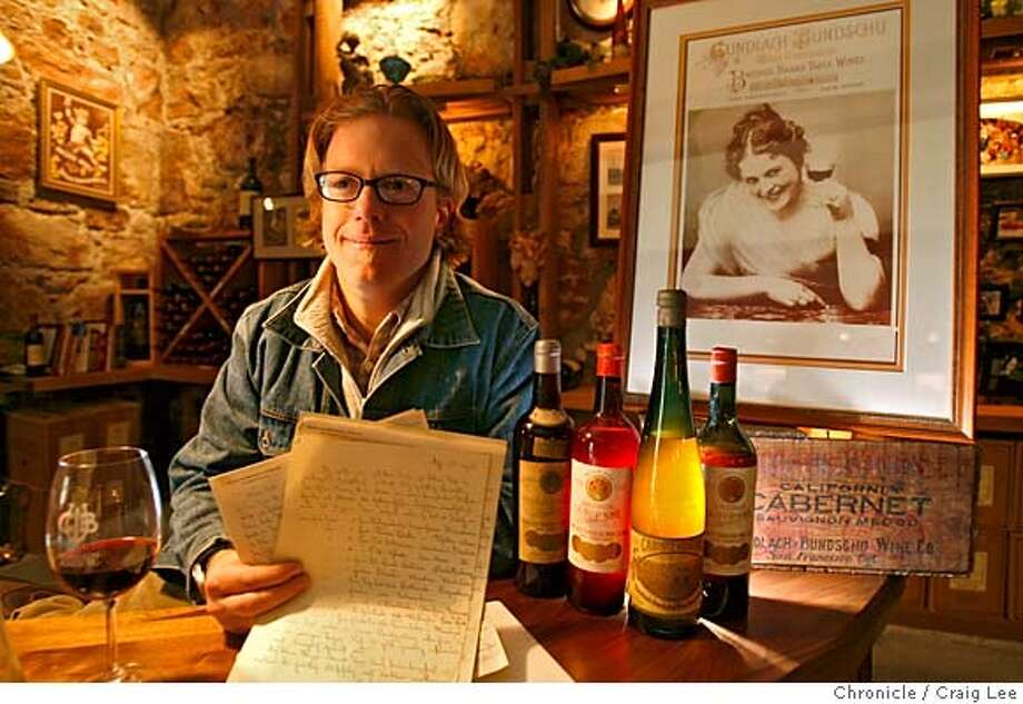 .JPG  Photo of Jeff Bundschu of Gundlach Bundschu Winery. The winery is still run by the same family during the 1906 earthquake. Photo of Jeff holding hand written paper by his Great Great Great Grandfather, Charles Bundschu, describing his first hand account of the earthquake. The Bundschu wine bottles and the poster are from the 1906 era.  Craig Lee / The Chronicle MANDATORY CREDIT FOR PHOTOG AND SF CHRONICLE/ -MAGS OUT Photo: Craig Lee