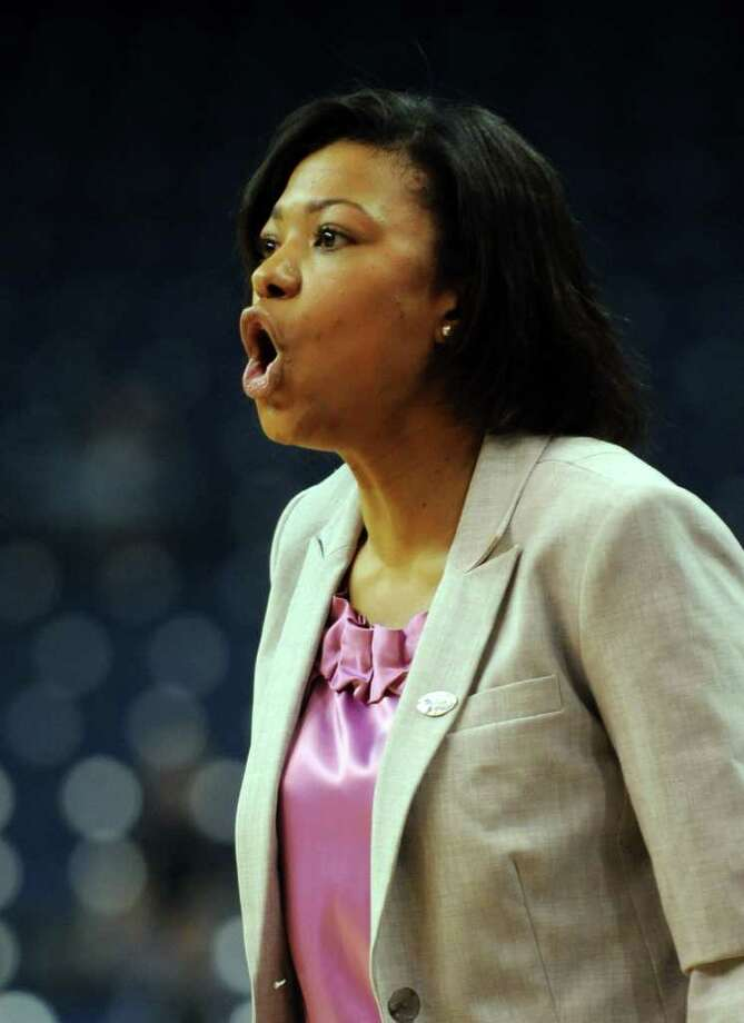 Prairie View A&M head coach Toyelle Wilson talks to her team during the first-round NCAA game against Connecticut at the Webster Bank Arena in Bridgeport, Conn. Saturday, Mar. 17, 2012. Photo: Autumn Driscoll / Connecticut Post