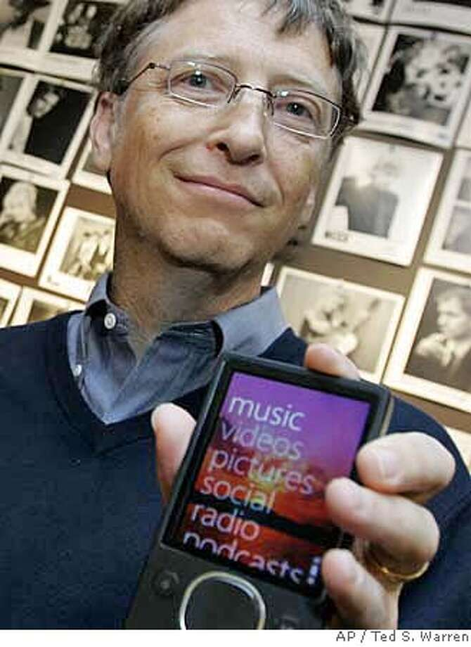 **EMBARGOED UNTIL 12:01 A.M. EDT, Oct. 3, 2007 ** Micosoft Corp. Chairman Bill Gates poses for a photo with one of three new Zune portable media players announced Tuesday, Oct. 2, 2007 at Microsoft headquarters in Redmond, Wash. Gates is holding an 80-gigabyte, hard-drive based Zune. (AP Photo/Ted S. Warren) Photo: Ted S. Warren