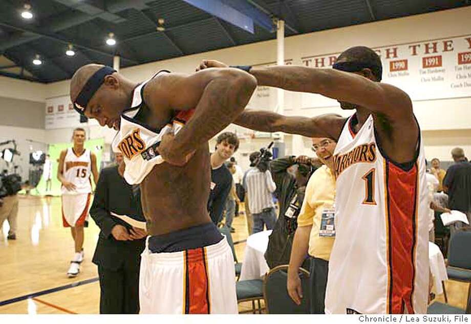 warriors_387_ls.jpg  From left: Al Harrington and Stephen Jackson. Jackson helps Harrington show off his tatoos during media day. Media day for Warriors as training camp starts. Lea Suzuki / The Chronicle Photo taken on 10/1/07, in Oakland, CA, USA �2007, San Francisco Chronicle  MANDATORY CREDIT FOR PHOTOG AND SAN FRANCISCO CHRONICLE/NO SALES-MAGS OUT Photo: Lea Suzuki