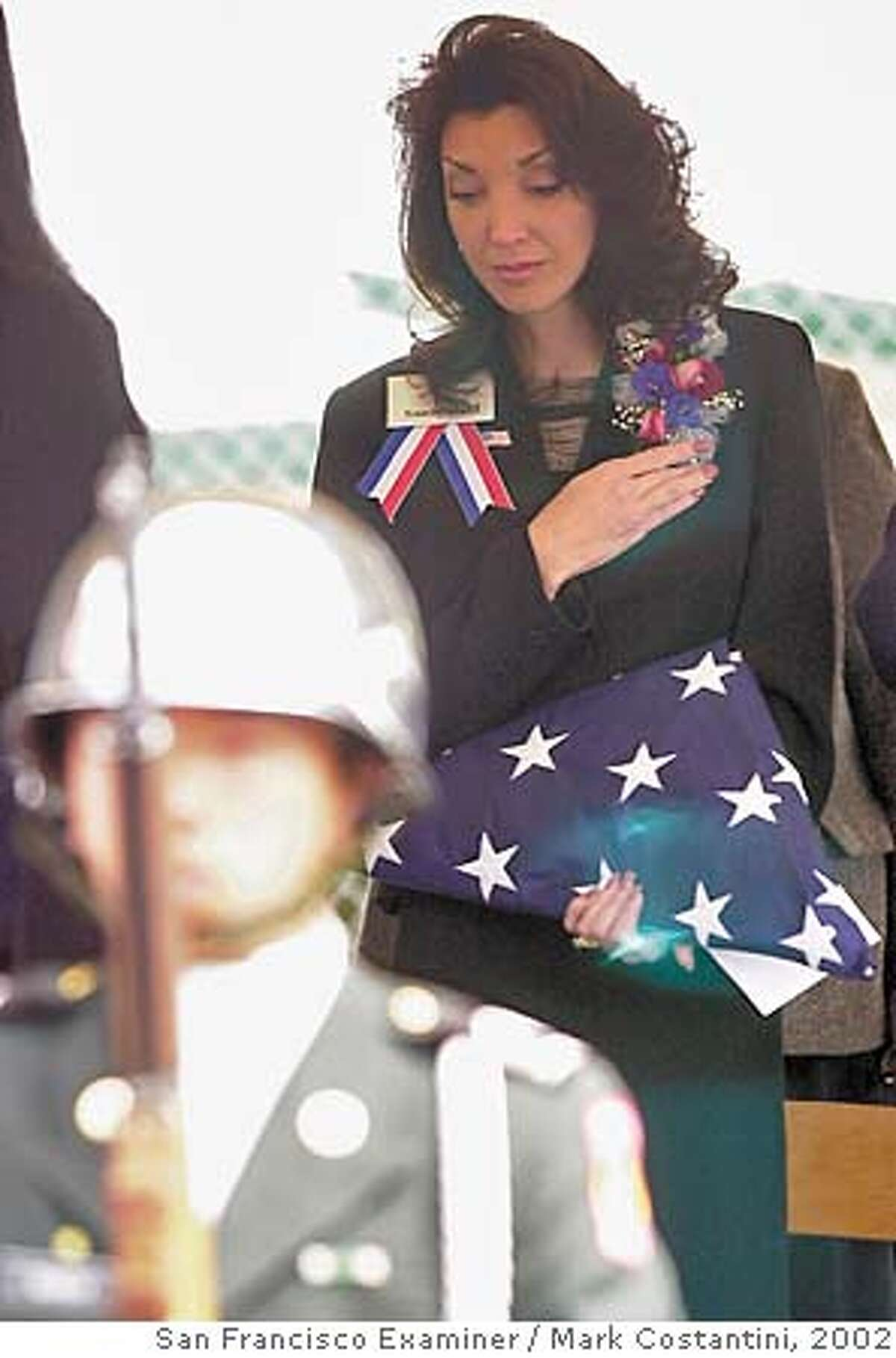 Sandy Dahl, widow of Jason Dahl, one of the pilots of United Airlines Flight 93, which crashed in Pennsylvania on Sept. 11, holds her hand over her heart during a ceremony held to change the name of Hillsdale Elementary School to Capt. Jason M. Dahl Elementary School Monday, March 25, 2002, in San Jose, Calif. Jason was a student at the school. (AP Photo/The San Francisco Examiner, Mark Costantini) CAT NORTHERN CA MANDATORY CREDIT PHOTOGRAPHER AND CHRONICLE