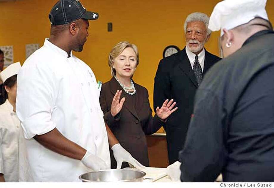 Hillary Clinton talks to Correy Williams (at left) as she tours a culinary fundamentals 1 and 2 class with Ron Dellums at Laney College. Hillary Clinton tours a culinary class and is endorsed by Mayor Ron Dellums at Laney College during an appearance at the Student Center. Lea Suzuki / The Chronicle Photo taken on 10/1/07, in Oakland, CA, USA Photo: Lea Suzuki