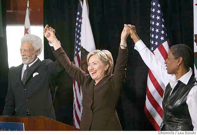 From left: Ron Dellums, Hillary Clinton and Cynthia Dellums raise and clasp hands after talking at Laney College. Hillary Clinton tours a culinary class and is endorsed by Mayor Ron Dellums at Laney College during an appearance at the Student Center. Lea Suzuki / The Chronicle Photo taken on 10/1/07, in Oakland, CA, USA Photo: Lea Suzuki