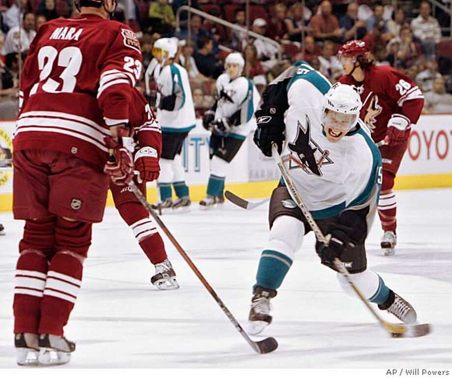 San Jose Sharks' Ville Nieminen of Finland winds up for a shot around Phoenix Coyotes' Paul Mara in first-period hockey action in Glendale, Ariz. Monday, April 10, 2006. (AP Photo/Will Powers) Photo: WILL POWERS