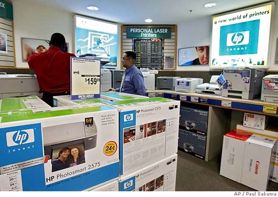 Hewlett-Packard Company printers are shown for sale at the Micro Center computer store in Santa Clara, Calif., Monday, Feb. 13, 2006. Hewlett-Packard Co. reports fiscal first-quarter results. Analysts expect the computer and printer maker to post a profit of 44 cents per share on sales of $22.55 billion. Developing after 4 p.m. EST market close. (AP Photo/Paul Sakuma)Ran on: 02-16-2006  HP printers are shown stacked up for sale at the Micro Center computer retail store in Santa Clara. Photo: PAUL SAKUMA