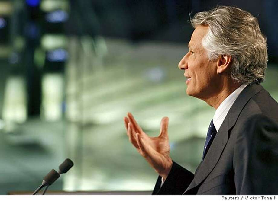 France's Prime Minister Dominique de Villepin speaks in the TF1 television studio before the evening news broadcast in Paris April 10, 2006. Villepin answered questions on the TF1 evening news programme after a decision earlier in the day by French President Jacques Chirac to scrap a planned youth job contract (CPE) that has provoked weeks of protests and a political crisis. REUTERS/Victor Tonelli 0 Photo: VICTOR TONELLI