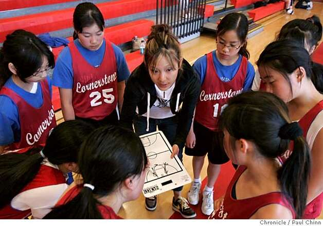 Cornerstone Eagles coach Tiffany Chew talks to her 6th Grade girls team during a timeout against the BAAS Dragons in the 6th annual Bay Area Asian Sports Dragons basketball tournament at Mercy High School on 4/1/06 in San Francisco, CA.  PAUL CHINN/The Chronicle MANDATORY CREDIT FOR PHOTOG AND S.F. CHRONICLE/ - MAGS OUT Photo: PAUL CHINN