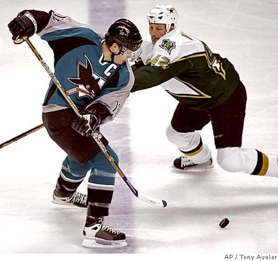 San Jose Sharks' Patrick Marleau, left, moves past Dallas Stars' Jon Klemm in the first period of NHL hockey action in San Jose, Calif., Sunday, April 9, 2006. (AP Photo/ Tony Avelar) Photo: TONY AVELAR