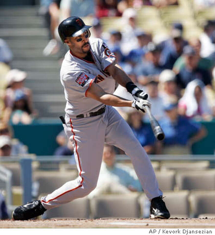 San Francisco Giants' Randy Winn hits a double to score Fred Davis against the Los Angeles Dodgers during the first inning of the baseball game at Dodger Stadium in Los Angeles Sunday, Sept. 30, 2007. (AP Photo/Kevork Djansezian) Photo: Kevork Djansezian