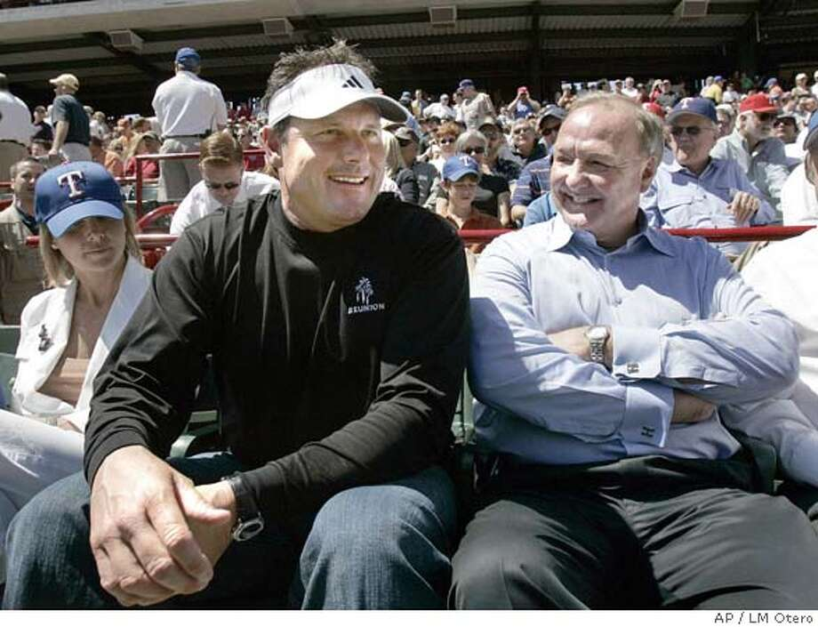 Roger Clemens, left, sits with Texas Rangers owner Tom Hicks before the start of the season opener against the Boston Red Sox in Arlington, Texas, Monday, April 3, 2006.(AP Photo/LM Otero) Photo: LM OTERO