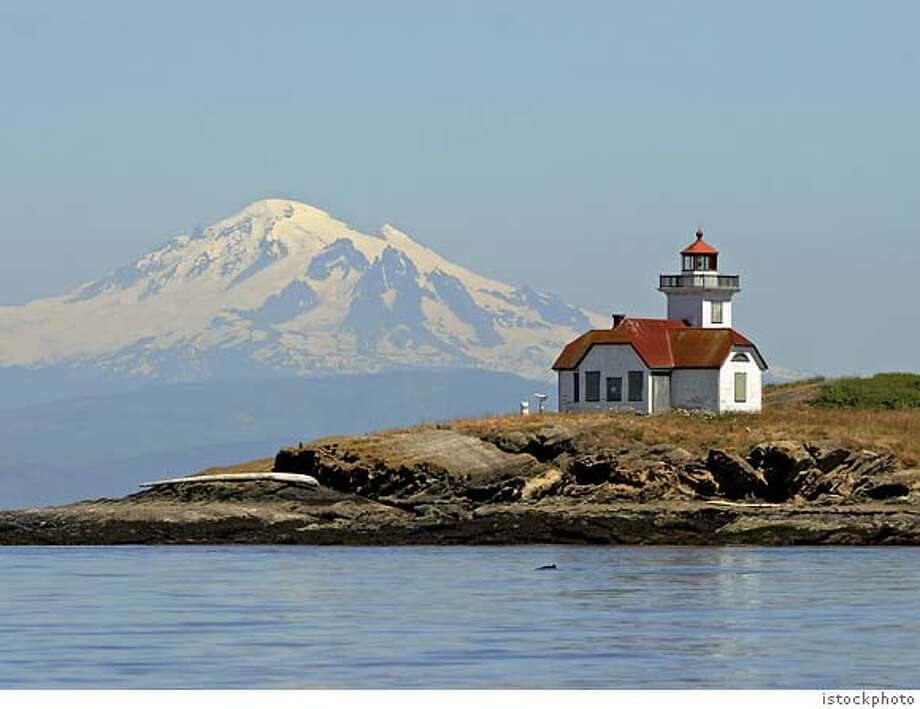 "TRAVEL FICTIONAL -- Washington State's San Juan Islands are the setting for the fictional San Piedro Island in ""Snow Falling on Cedars."" Pictured is Patos Island with Mount Baker in the background. Photo: Istockphoto"
