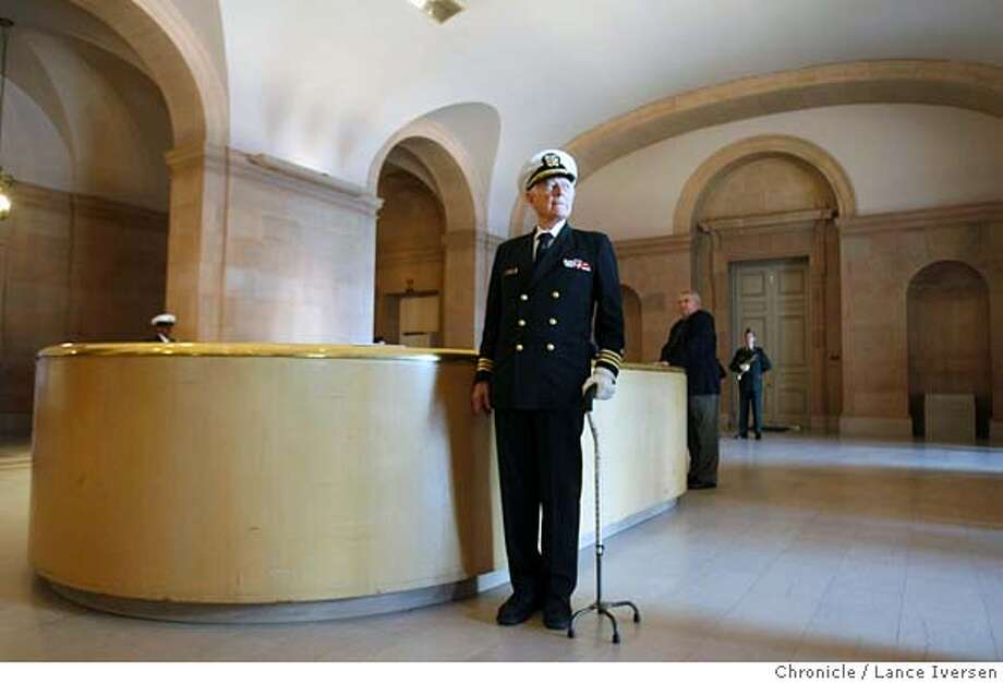 POW_0048.jpg_  Retired Commander Robert Lando attending POW Recognition Day stands at attention inside the War Memorial Building during taps Saturday. The Veteran�s War Memorial Commission hosts POW Recognition Day Saturday, paying Special tribute to POWs from Corregidor and the Bataan Death at the War Memorial Building in San Francisco. By Lance Iversen/San Francisco Chronicle MANDATORY CREDIT PHOTOG AND SAN FRANCISCO CHRONICLE. Photo: Lance Iversen