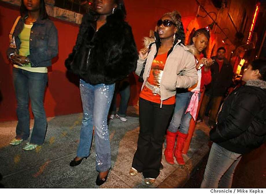 onlocationFernVanNess275_mk.JPG  6:57 p.m. Holding general admission tickets to see teen R&B star, Chis Brown, Porche Arrington, 18, waits in a long line with her friends for the doors to open to the Grand Ballroom at the Regency Center.  on location Fern and Van Ness - hundreds of adoring fans line up to see Chris Brown, teen R&B star, who performed at The Grand At the Regency Center Mike Kepka / The Chronicle MANDATORY CREDIT FOR PHOTOG AND SF CHRONICLE/ -MAGS OUT Photo: Mike Kepka