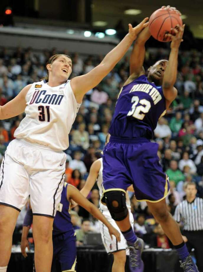 Prairie View's Kiara Etienne gets the rebound as Connecticut's Stefanie Dolson defends during the first-round NCAA game at the Webster Bank Arena in Bridgeport, Conn. Saturday, Mar. 17, 2012. Photo: Autumn Driscoll / Connecticut Post