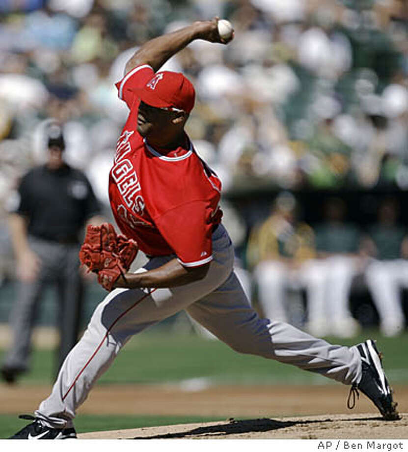 Los Angeles Angels' Kelvim Escobar works against the Oakland Athletics during the first inning of a baseball game Saturday, Sept. 29, 2007, in Oakland, Calif. (AP Photo/Ben Margot) Photo: Ben Margot