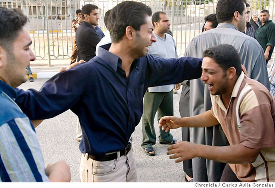 Three men react as they learn that a loved one was one of the dead brought to Baghdad Teaching Hospital. Family members of the dead and injured gathered at Baghdad Teaching Hospital on Friday afternoon, April 7, 2006, following a blast at a Shia mosque in western Baghdad that reportedly killed at least 75 people. The attack on the mosque was carried out by as many as four suicide bombers according to a several reports. Photo by Carlos Avila Gonzalez / The San Francisco Chronicle  Photo taken on 4/7/06 in Baghdad, Al Anbar Province, IRAQ. Photo: Carlos Avila Gonzalez