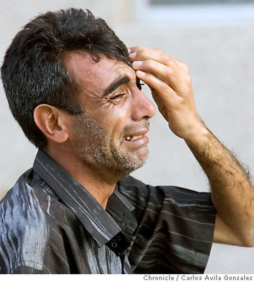 An Iraqi man is overcome with emotion as he waits to learn the fate of a loved one at Baghdad Teaching Hospital following a suicide bomber attack on a mosque in the city. Family members of the dead and injured gathered at Baghdad Teaching Hospital on Friday afternoon, April 7, 2006, following a blast at a Shia mosque in western Baghdad that reportedly killed at least 75 people. The attack on the mosque was carried out by as many as four suicide bombers according to a several reports. Photo by Carlos Avila Gonzalez / The San Francisco Chronicle  Photo taken on 4/7/06 in Baghdad, Al Anbar Province, IRAQ. Photo: Carlos Avila Gonzalez
