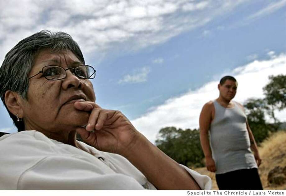 DYINGLANGUAGE_0078_LKM.jpg Loretta Kelsey (left) is the last remaining fluent speaker of the Elem Pomo language. She is trying to pass the language onto others including her grandson Joe Peters (right) so it does not die with her. (Laura Morton/Special to the Chronicle) *** Loretta Kelsey  *** Joe Peters Photo: Laura Morton