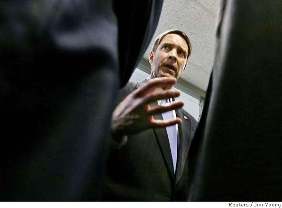U.S. Senate Majority leader Bill Frist (R-TN) speaks with Republican Senators in a hallway prior to a news conference on immigration on Capitol Hill in Washington April 7, 2006. REUTERS/Jim Young 0 Photo: JIM YOUNG