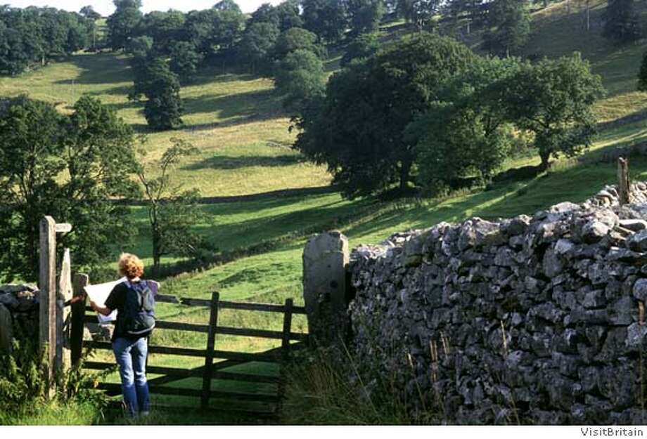 "TRAVEL FICTIONAL -- The rolling, sheep-dotted hills around Askrigg in England's Wensleydale were the setting for both the book and television show, ""All Creatures Great and Small."" Credit: VisitBritain Photo: VisitBritain"