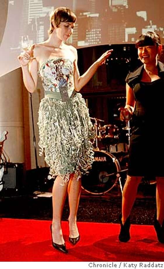 """FOODFASH30_098_RAD.jpg  SHOWN: The Tres Agaves dress. """"Toast of the Town: Where Food Meets Fashion"""" is the Golden Gate Restaurant Association's annual event, held here at the Old Federal Reserve Building at 301 Battery St. in San Francisco, featuring entertainment, eats, and edible designs.  (Katy Raddatz/The Chronicle)  **  Ran on: 09-30-2007  A margarita-inspired dress made from 75 Tequila labels and braided lime rinds, designed by Kimie Sako (right) and Stephanie Verri�res. Photo: Katy Raddatz"""
