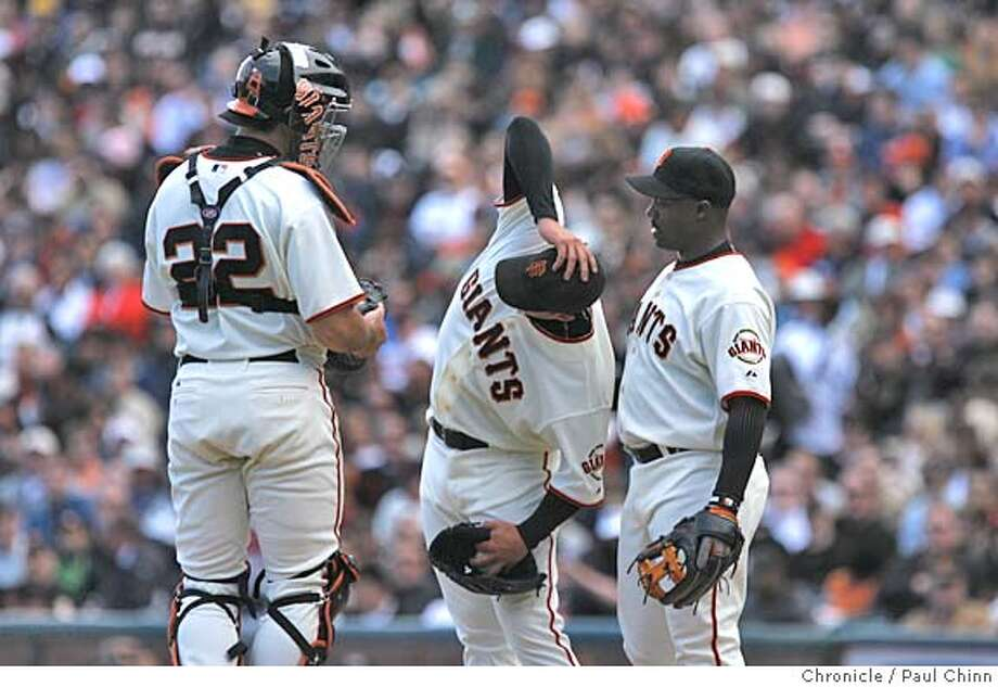 Noah Lowry stretches his back before coming out of the second inning. The San Francisco Giants opened their 2006 home schedule against the Atlanta Braves at AT&T Park. Starting pitchers are Noah Lowry for the Giants and Jorge Sosa for the Braves on April 6, 2006 in San Francisco. Photo: Paul Chinn