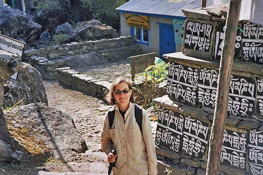TRAVEL JUSTBACK -- Janna Scopel, San Francisco Email: jscopel@truckerhuss.com  Daytime phone number: 415-277-8024 Just back from: Khumbu Valley, Everest Region, Nepal I went because: To experience the awesome grandeur of the Himalayas and to visit Buddhist Sherpa villages. Don't miss: The chanting monks of Tengboche Monastery at 13,000'. Go to their evening service, you will be transported. Don't bother: Thangka painting workshops, unless you're really interested in buying and can differentiate between imitations and the real thing. Coolest souvenir: Unique silver handicrafts and Pashmina scarfs at $5 can't be beat. Worth a splurge: Hiring a driver and car to visit UNESCO World Heritage site at Bhaktapur. I wish I'd packed: A second hiking stick! Other comments: The Nepalese are some of the most gracious and friendliest people I've ever met. Details of attached photo (if sent): Janna in front of Mani prayer wall in Khumbu Valley. 8/27/07 in , . Photo: NA