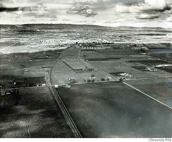 Date Unknown - Sunnyvale annexed for industry the plain of land in the foreground above, SP tracks just left of center, then cut Kifer road into it, curving parallel to the tracks. This picture was taken shortly after Kifer was cut, but before industries began to speckle the plain. General Motors will build along Lawrence Station road, which cuts left to right a little below center across the picture. Lockheed and Sperry Gyroscope plan to locate in the area too. photographer unknown/ San Francisco Chronicle File Photo Photo: Photographer Unknown