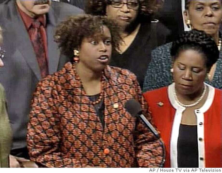In this photograph from video, Rep. Cynthia McKinney, D-Ga., stands on the floor of the House of Representatives on Capitol Hill in Washington, Thursday, April 6, 2006 as she apologizes for her earlier altercation with a Capitol Hill police officer. (AP Photo/House TV via AP Television) PHOTO FROM VIDEO Photo: APTV