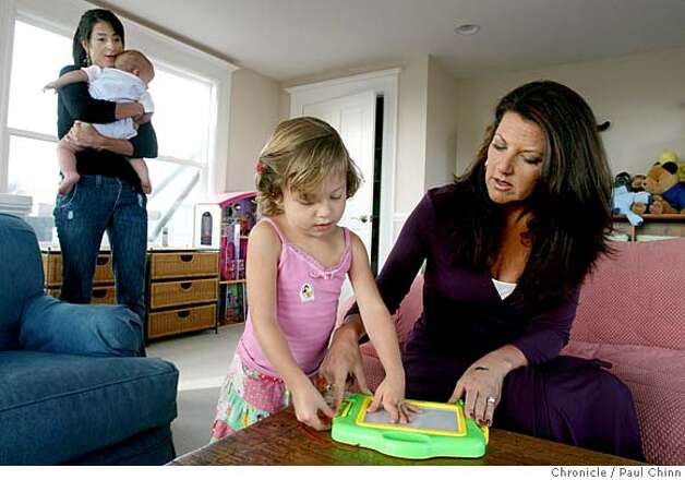 Lonna Corder (right) plays a game with Audrey Harper, 3, while mom Kristen Harper (left) tends to eight-month-old son Ashley, at Harper's home in San Francisco, Calif. on Thursday, Sept. 13, 2007. Corder is launching a new business called Lonna's Individual Parenting Plan (LIPP).  PAUL CHINN/The Chronicle  **Lonna Corder, Kristen Harper, Audrey, Ashley MANDATORY CREDIT FOR PHOTOGRAPHER AND S.F. CHRONICLE/NO SALES - MAGS OUT Photo: PAUL CHINN