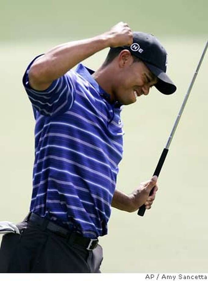 Tiger Woods reacts to his birdie on the 18th hole during first round play of the Masters golf tournament at the Augusta National Golf Club in Augusta, Ga., Thursday, April 6, 2006. (AP Photo/Amy Sancetta) Photo: AMY SANCETTA