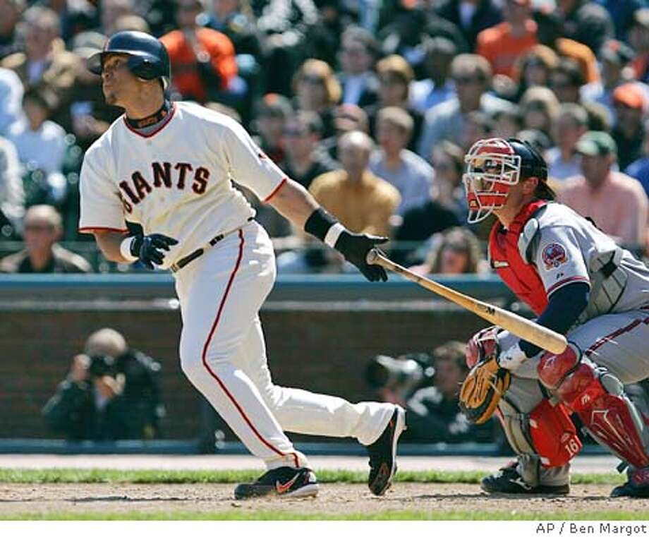 San Francisco Giants' Pedro Feliz, left, swings for a three-run double off Atlanta Braves' Jorge Sosa in the third inning of a baseball game as Braves' catcher Brian McCann watches Thursday, April 6, 2006, in San Francisco. (AP Photo/Ben Margot) Photo: BEN MARGOT