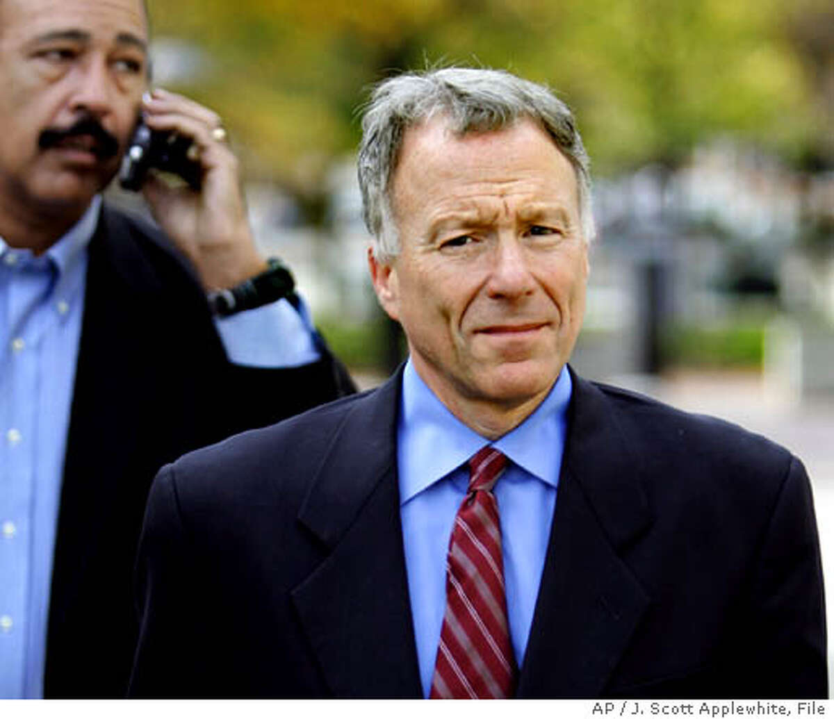 """** FILE** I. Lewis """"Scooter"""" Libby, Vice President Dick Cheney's former chief of staff, walks to the U.S. District Court in Washington, in this Nov. 16, 2005 file photo, accompanied by his attorney Theodore V. Wells Jr., at rear. Libby told prosecutors President Bush authorized the leak of sensitive intelligence information to a reporter, according to a new court filing in the CIA leak case. (AP Photo/J. Scott Applewhite)"""