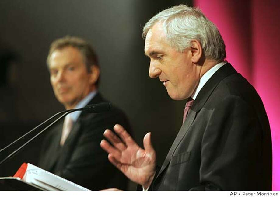 British Prime Minster Tony Blair, left, and Irish Prime Minister Bertie Ahern, right, speak to the media at a press conference in the Navan Centre, Armagh, Northern Ireland Thursday, April, 6, 2006. The British and Irish prime ministers, Tony Blair and Bertie Ahern, declared Thursday that Northern Ireland's legislature will be reconvened May 15 in what was called a final push to revive power-sharing between Protestants and Catholics. (AP Photo/Peter Morrison) Photo: PETER MORRISON