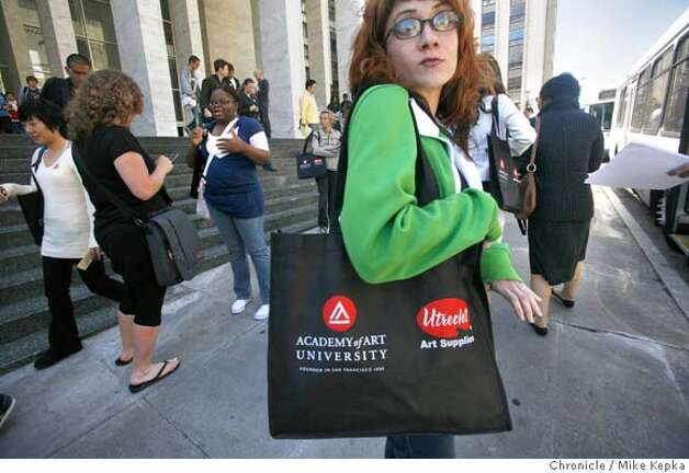 In this file photo, on student orientation day at the Academy of Art University in San Francisco, Nyoka Jameson,a first time graduate student, here for painting from Bakersfield, Calif., looks for the correct Academy bus to take her to the Fine Arts building for the first time. Photo: Mike Kepka