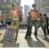 artschool00638_mk.JPG On the first day classes at the Academy of Art University in San Francisco, on New Montgomery street, new students orient themselves while waiting for an Academy bus to take them where they need to go.  9/6/07. Mike Kepka/The Chronicle (cq)