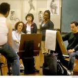 artschool01107_mk.JPG With graduate students Yuni Hong, Sola Sawyer and Bernardo Warman watching intently, Lis Berrett, Asst. director of the School of Illustrations at the Academy of Art University, leads a drawing lesson during a clothed model figure drawing class on the top floor of the Illustration building on Powell Street. 9/14/07. Mike Kepka/The Chronicle (cq)