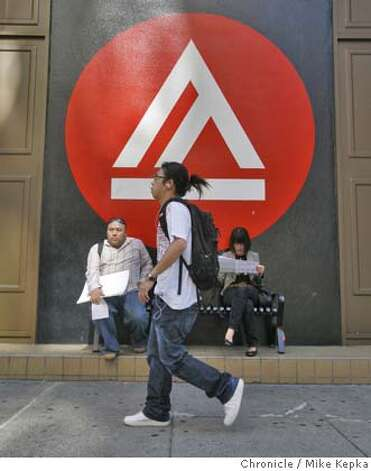 In this file photo, students walk past one of the infamous Academy of Art University of San Francisco insignia plastered up and down the street on New Montgomery in San Francisco. Photo: Mike Kepka
