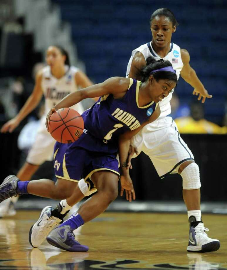 Prairie View's LaReahn Washington drives past  Connecticut's Brianna Banks during the first-round NCAA tournament college basketball game at the Webster Bank Arena in Bridgeport, Conn. Saturday, Mar. 17, 2012. Photo: Autumn Driscoll / Connecticut Post