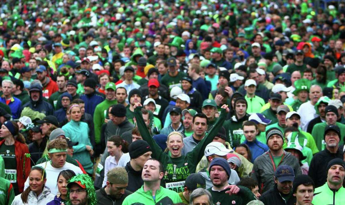 Participants line up at the start line during a soggy St. Patrick's Day Dash on Saturday, March 17, 2012 in downtown Seattle. Thousands of people participated in the annual event. By the end of the race large snowflakes were falling on participants.