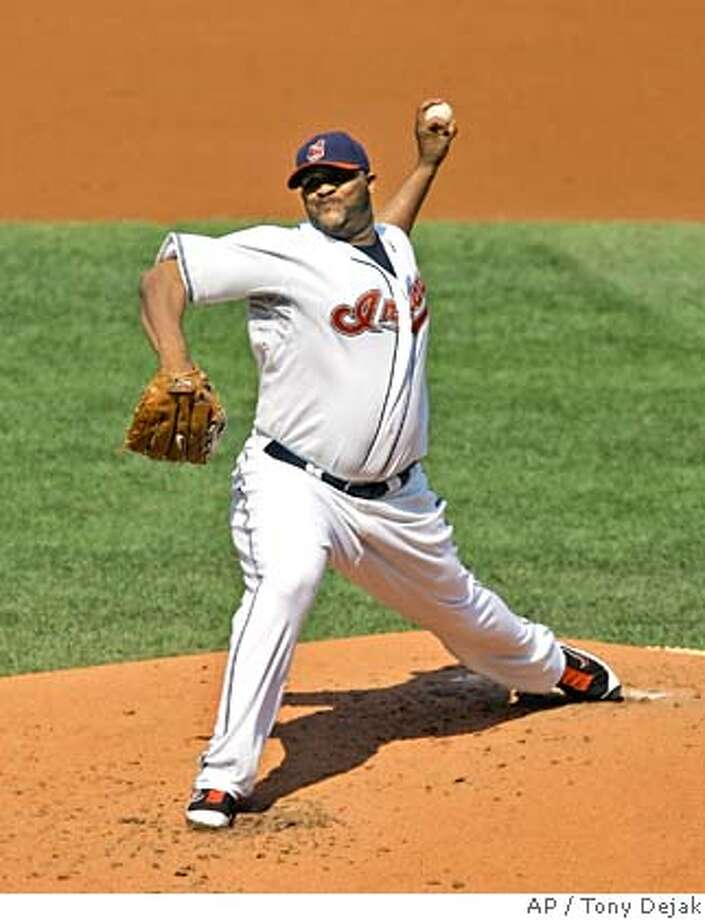 Cleveland Indians' C.C. Sabathia pitches to Detroit Tigers' Magglio Ordonez in the second inning of a baseball game Wednesday, Sept. 19, 2007, in Cleveland. Sabathia upgraded his Cy Young resume and Cleveland finished declawing the Tigers with a 4-2 win that completed a three-game sweep and reduced the Indians' magic number for clinching the AL Central to three. (AP Photo/Tony Dejak) EFE OUT Photo: Tony Dejak