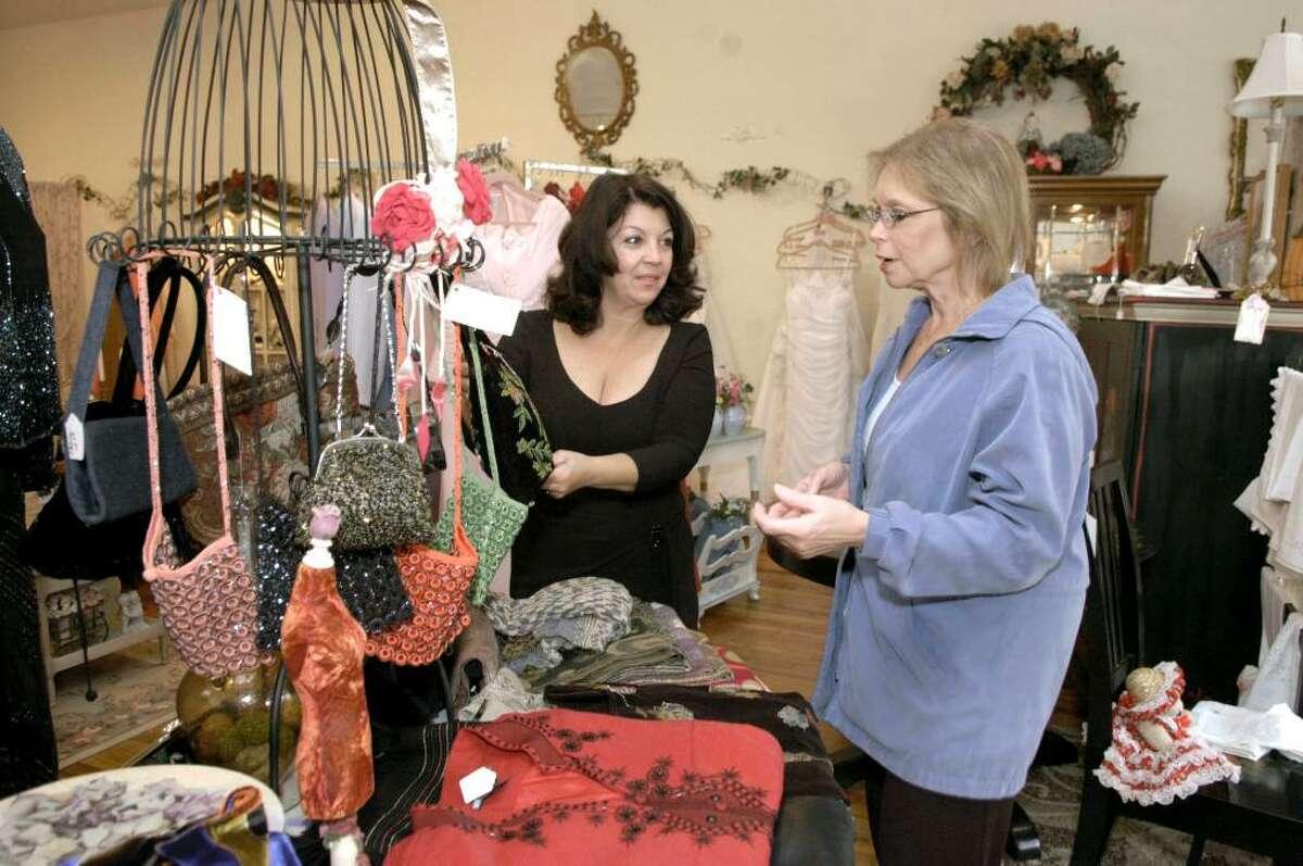 Debbie Negri, owner of Elizabeth Adams on W. Wooster St. in Danbury, shows items to custumer Kathy Donaldson of New Fairfield Wednesday, November 4, 2009.