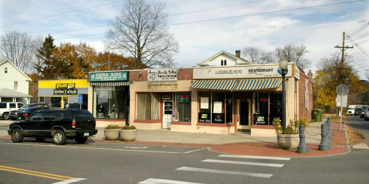 A small strip of businesses on Division St. that include an auto repair place, two restaurants and a beauty salon. The businesses are part of the Wooster Village area of Danbury.