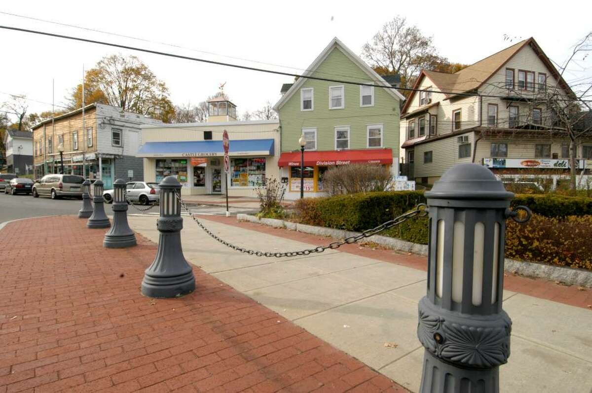 A sidewalk area on the traffic island at the intersection of Division and West Wooster Sts. The area is in the Wooster Village section of Danbury.