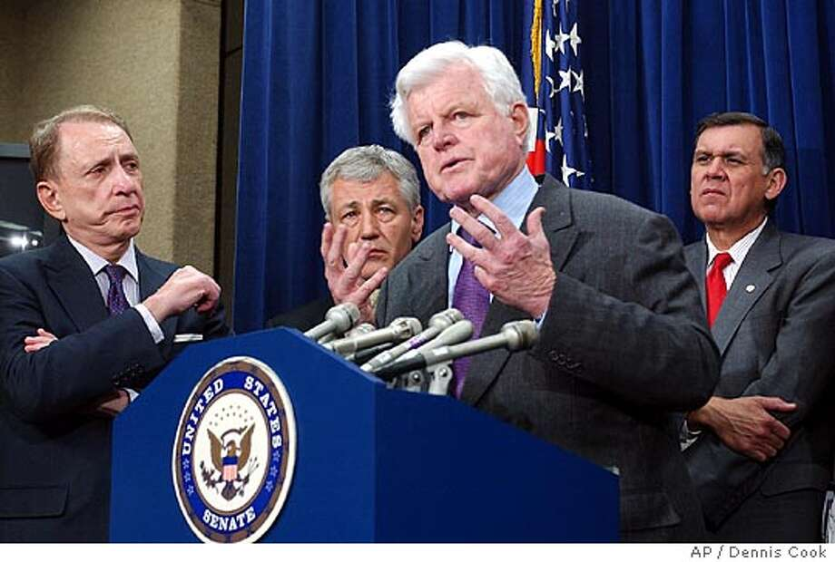 Sen. Edward Kennedy, D-Mass., second from right, joined by Senate Democrats and Republicans gestures during a Capitol Hill news conference , Thursday, April 6, 2006, where it was announced that they are close a compromise on immigration legislation. From left are Sen. Arlen Specter, R-Pa., Sen. Chuck Hagel, R-Neb., Kennedy, and Sen. Mel Martinez, R-Fla. (AP Photo/Dennis Cook) Photo: DENNIS COOK