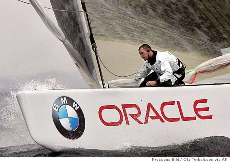 US challenger yacht BMW Oracle Racing crew works at a turning point in the match race against South African Team Shosholoza (not in picture) Thursday Aug. 25, 2005 outside Malmo, Sweden, of the Malmo-Skaane Louis Vuitton act 6 ahead of the 32nd America's Cup set in Valencia, Spain in 2007. Oracle won the race. (AP Photo/Pressens Bild/Ola Torkelsson) ** SWEDEN OUT ** Photo: Ola Torkelsson