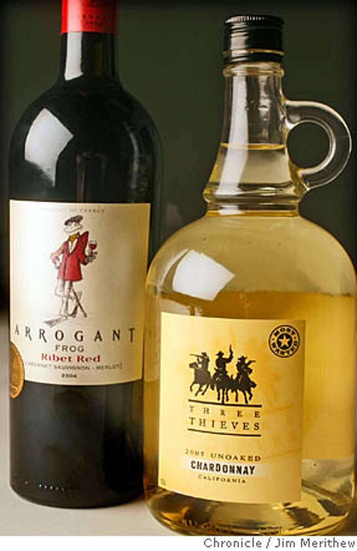 Three Thieves Unoaked Chardonnay, at right, and Arrogant Frog Ribet Red JIM MERITHEW SFC MANDATORY CREDIT FOR PHOTOG AND SAN FRANCISCO CHRONICLE/ -MAGS OUT