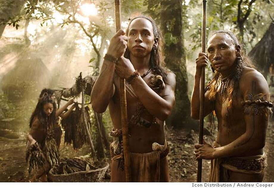 """** FILE ** In this undated file promotional photo released by Icon Distribution, Inc., actors Rudy Youngblood, center, and Morris Bird, right, appear in a scene from Mel Gibson's epic drama """"Apocalypto."""" """"Apocalypto"""" debuted as the No. 1 weekend movie.(AP Photo/Icon Distribution, Andrew Cooper/SMPS)  Ran on: 12-24-2006  Rudy Youngblood in &quo;Apocalypto&quo;: film of genius? Photo: ANDREW COOPER"""