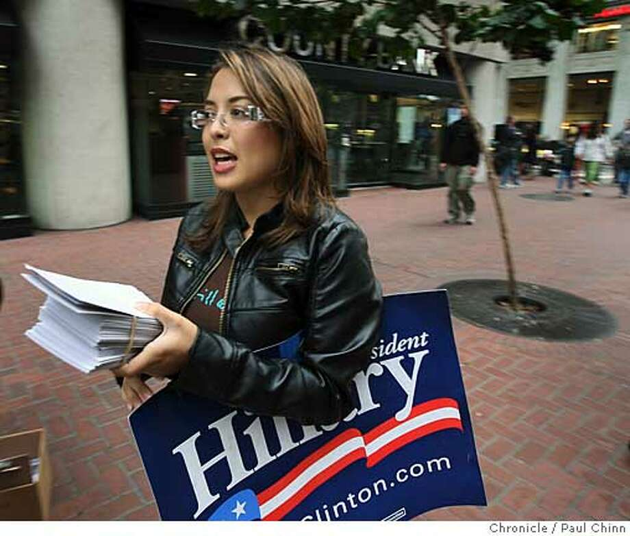 Zehra Ahsan distributed free tickets for this weekend's Hillary Clinton campaign rally outside the Montgomery BART station in San Francisco, Calif. on Friday, Sept. 28, 2007. Ahsan volunteers as many as 100 hours a week on Clinton's campaign.  PAUL CHINN/The Chronicle  **Zehra Ahsan  Ran on: 09-30-2007  Zehra Ahsan distributes tickets Friday outside a San Francisco BART station for today's Hillary Clinton campaign rally in Oakland. Photo: PAUL CHINN